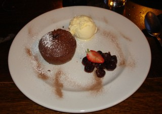 Chocolate fondant pudding with cherries