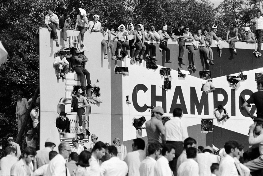 "Italian fans occupy Agip""s advertising billboard as a temporary grandstand, Italian GP Monza 1968, Italy"