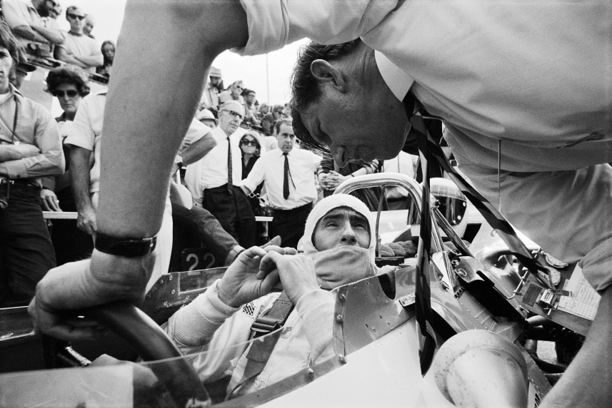 J Stewart sits in his Matra-Cosworth MS80 and speaks with team principal K Tyrrell on the grid before the 1969 British GP,  Silverstone, July 1969