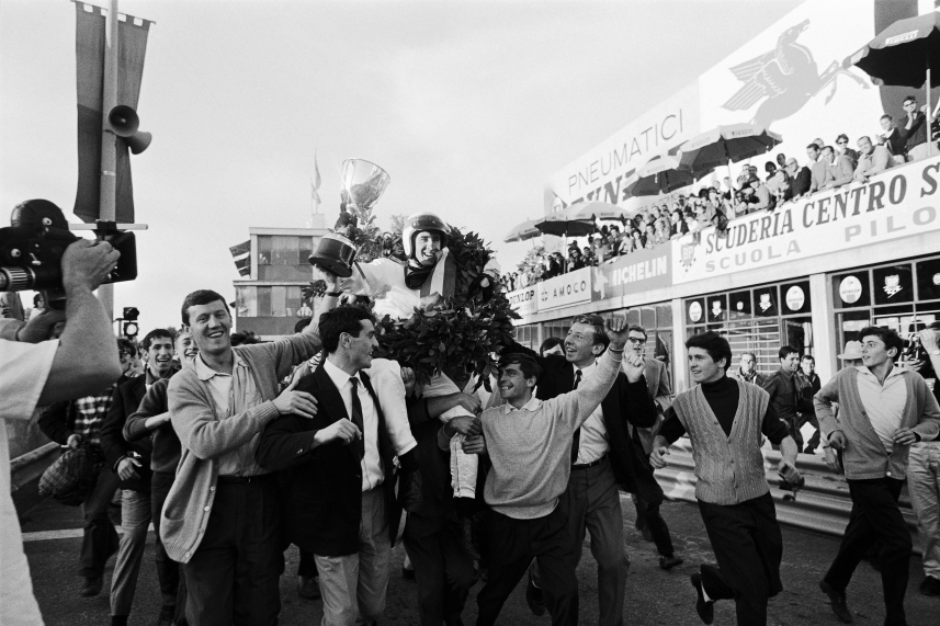 Race winner J Stewart is being carried by cheering fans after the Italian Grand Prix at Monza in 1965