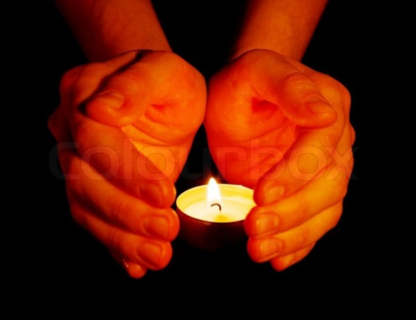 3962321-candle-in-a-hand
