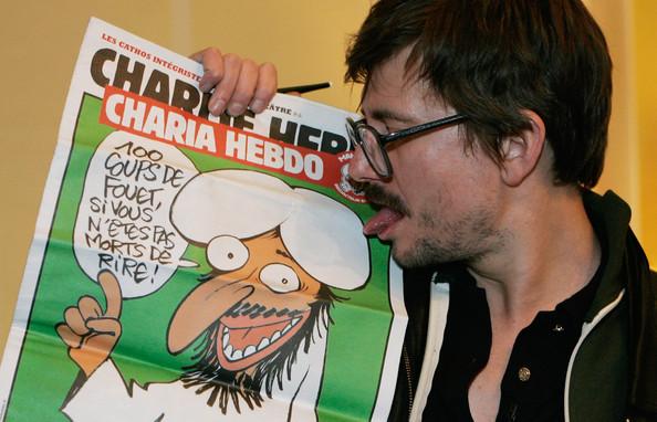Charlie-Hebdo-First-Team-Meeting-After-Terrorist-2vsDg9kfg_Ul