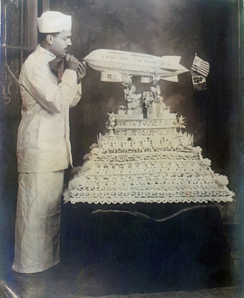 Antonio Ninni, an Italian-American baker, decorates an airship-themed wedding cake in his Akron, Ohio bakery circa 1930