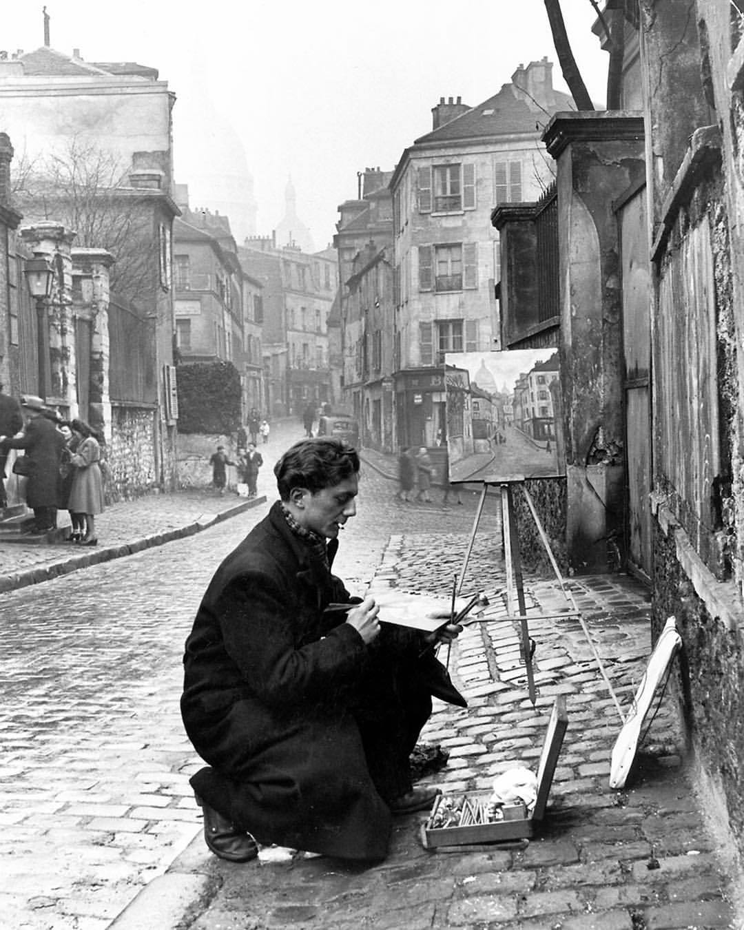 A young artist painting the Sacre-Coeur from the ancient Rue Narvins in Montmartre in 1946