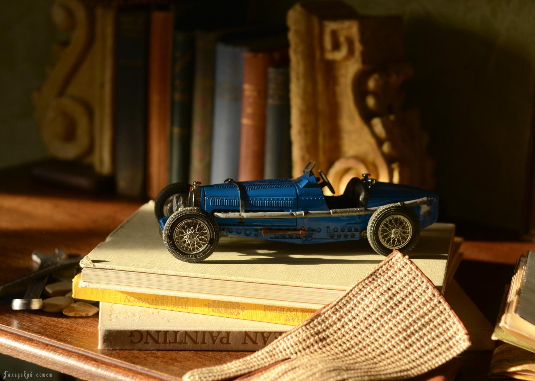 Still Life with Books and Bugatti model