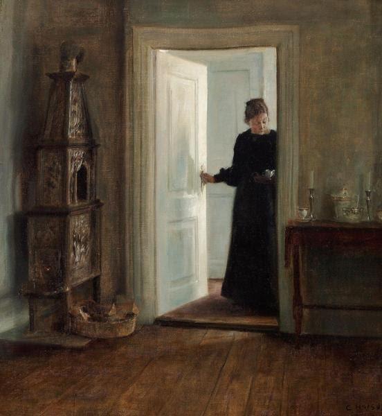 Carl Holsøe (1863-1935). Kunstnerens hustru med bakke i en døråbning. Sign. C. Holsøe