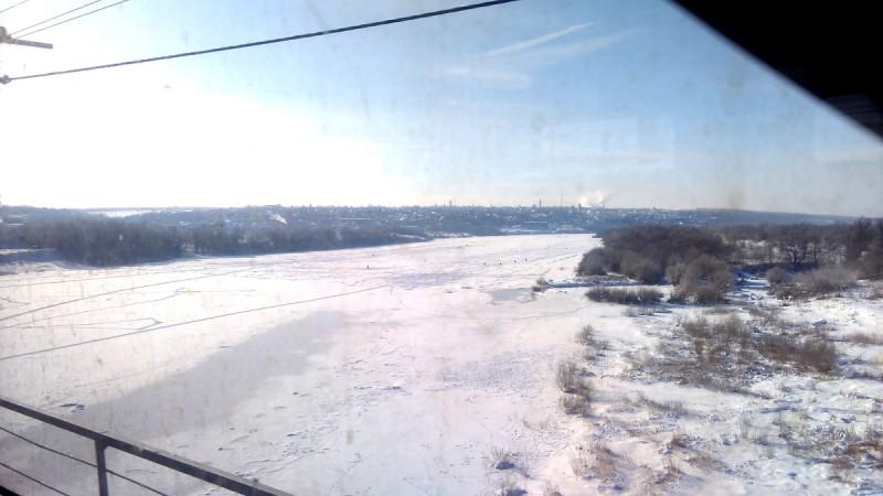 Жаль, но фото со смартфона через грязное окно поезда не передает ту красоту, которая доступна человеческому глазу.
