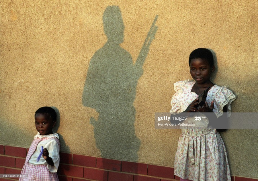 military man protects children at a church on April 21, 1994 in Lindelani, South Africa.jpg