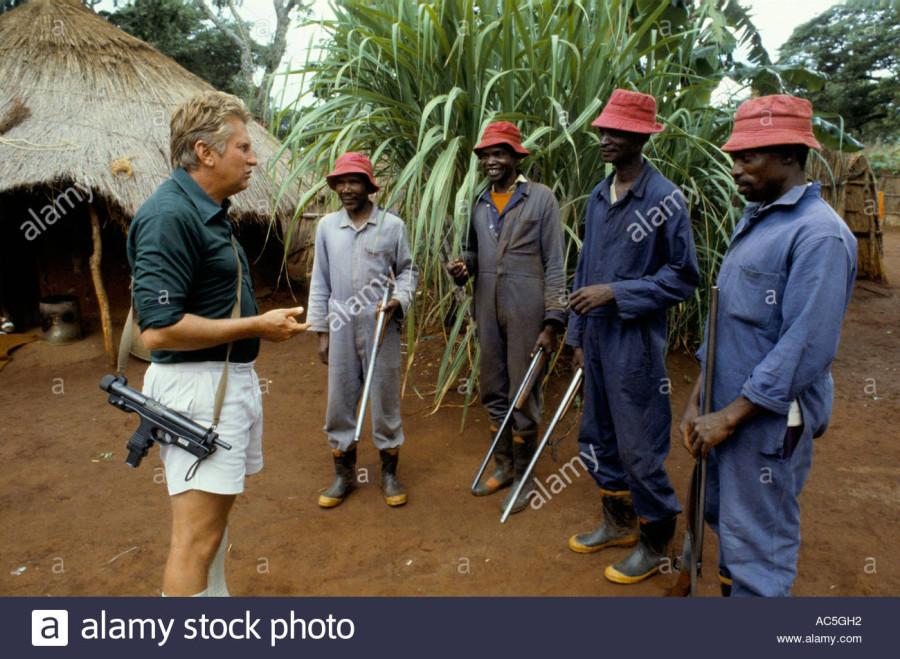 Rhodesian parliament member Andre Holland talks to guards on his farm.jpg
