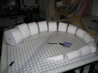The 12 segments plus the  tip of the tail, carved out of the foam slab
