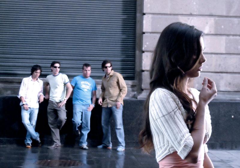 woman-walking-in-front-men-(1)