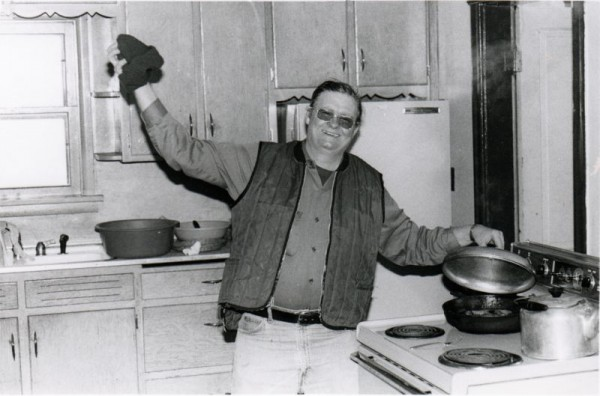Dad playing the chef during deer hunting season sometime in the 80s.