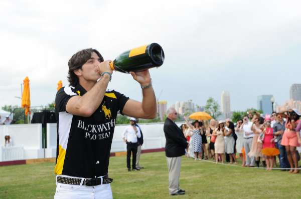 others-such-as-nacho-figueras-celebrated-his-win-by-guzzling-a-giant-bottle-of-veuve-clicquot
