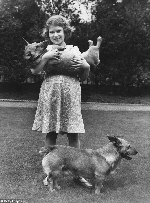 2A8AEA9800000578-3161789-Princess_Elizabeth_now_Queen_Elizabeth_II_with_two_corgi_dogs_at-a-3_1436956314269