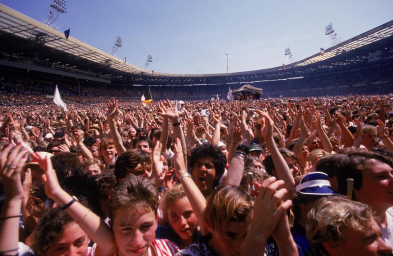 A view of the crowd at the Live Aid charity concert, Wembley Stadium, London, 13th July 1985. (Photo by Dave Hogan/Hulton Archive/Getty Images)