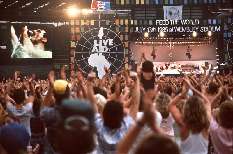Fans cheer during Queen's performance. (Norbert Foersterling/DPA/ZUMA Press)