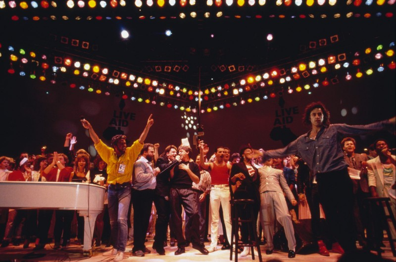 Mercury, at center in the red shirt, is joined by George Michael, Bono, Paul McCartney and others during the Live Aid show at Wembley Stadium. (Georges De Keerle/Getty Images)