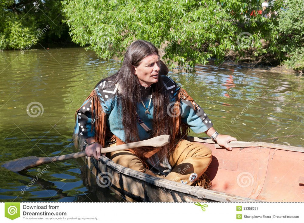 north-american-indian-floats-down-river-canoe-33358327.jpg
