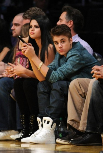 Laker fan Justin Beiber and his girlfriend Selena Gomez at Staples Center