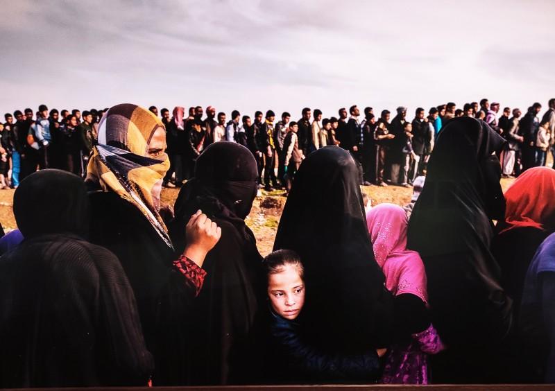 Ivor Prickett Civilians line up for aid distribution in the Mamun neighbourhood, Iraq