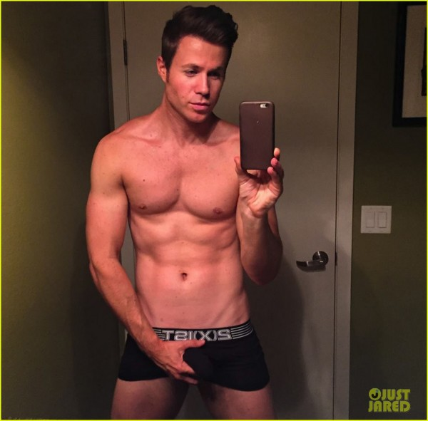ashley-parker-angel-goes-shirtless-grabs-crotch-03