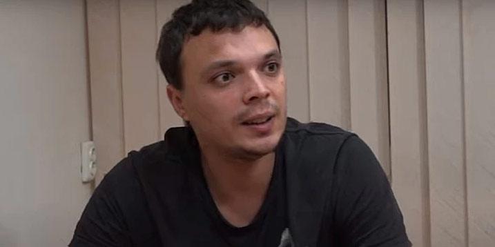 Сергей Лукьяненко, скриншот с видео, где он дает показания
