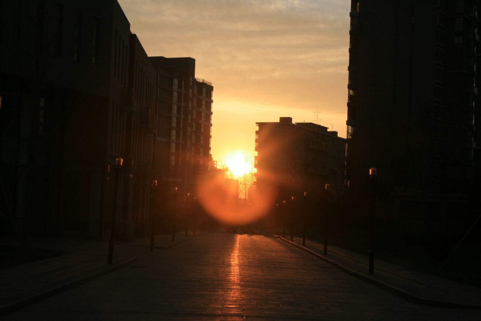 A sunrise in an oriental city.