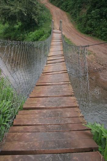 A wooden suspension bridge.