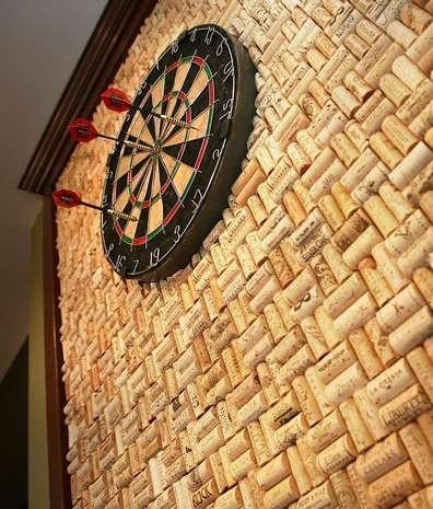wine corks for backdrop of dart board