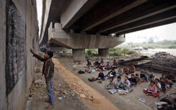 School founded by Rajesh Kumar Sharma, under a metro rail bridge, in New Delhi, India.