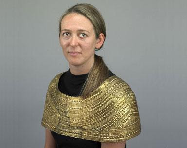 gold cape europe wearing