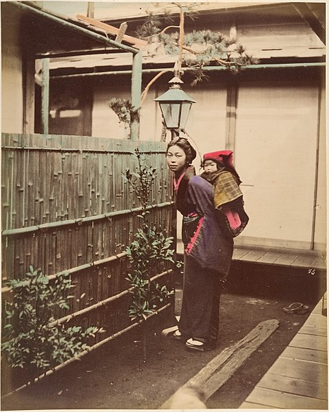 Japanese Woman in Traditional Dress Posing with a Child on her Back