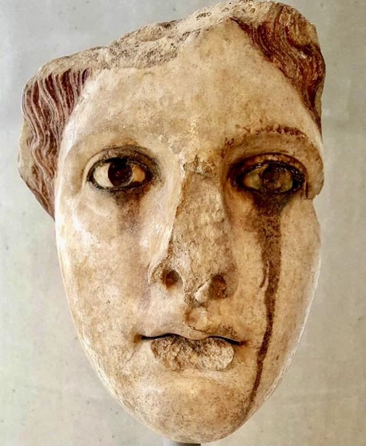 Marble head of a woman. Acropolis Museum, Athens, Greece.