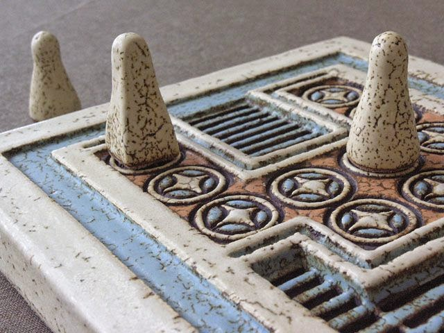 detail shot of pieces and the Minoan board game