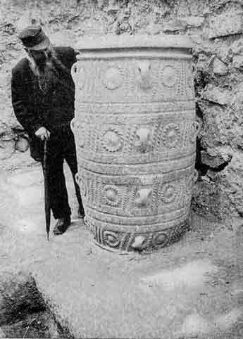 a person standing next to a pithos jar from Knossos