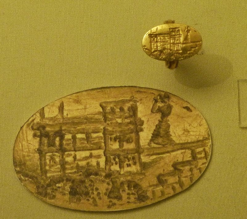Minoan ring with a figure and a building, from Poros on Crete 1600-1450 new palace period