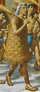 reconstruction of celebrant wearing scaled costume as seen on the Harvester Vase Minoan