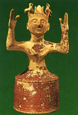 Minoan clay figurine of a goddess with a 'crown of doves'