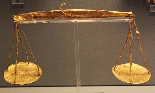 1500s Mycenaean gold scales found in tomb, one scale inscribed with image of butterfly