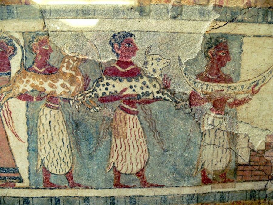 detail from Agia Triadha sarcophagus, showing three men wearing skirts bringing animal offerings