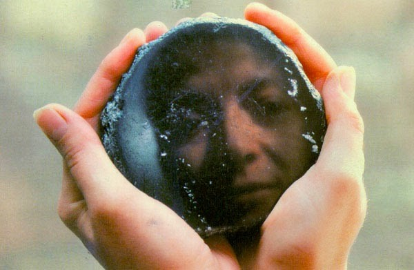 a person's image being reflected in an ENeolithic obsidian mirror from Catalhoyuk