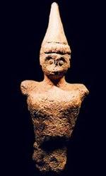 high conical helmet on Cretan figurine ca 1900-2000 bce