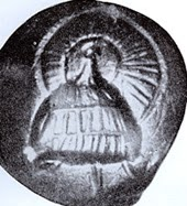 boar tusk helmet with circular crest on a seal from chamber tomb 518 at Mycenae