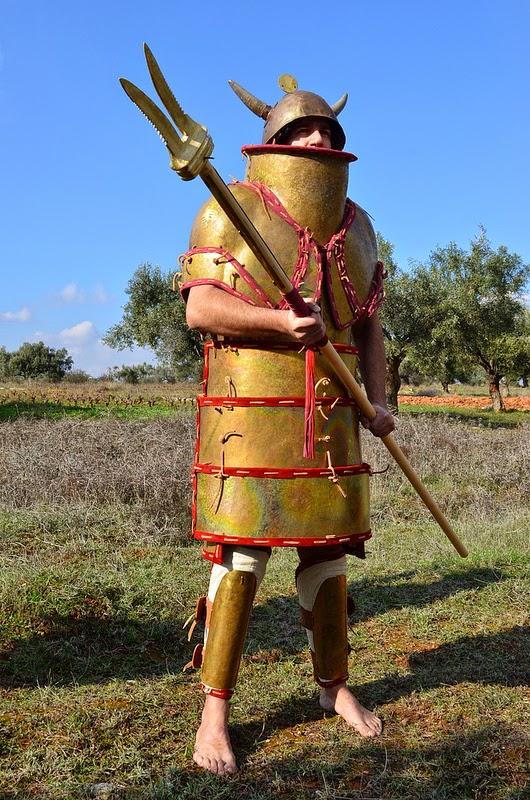 Mycenaean Eqeta reenactor with dual pronged cretan spear, from koryvantes.org