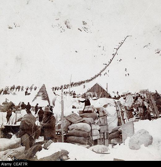 Climbing the Chilkoot Pass during the Klondike gold rush, Alaska USA in 1898