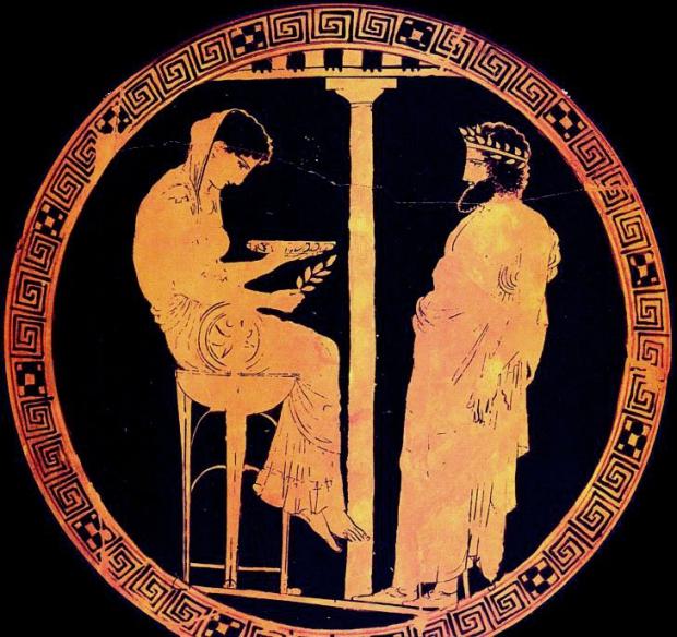 Пифия, сидящая на треножнике с ветвью лавра в руке.