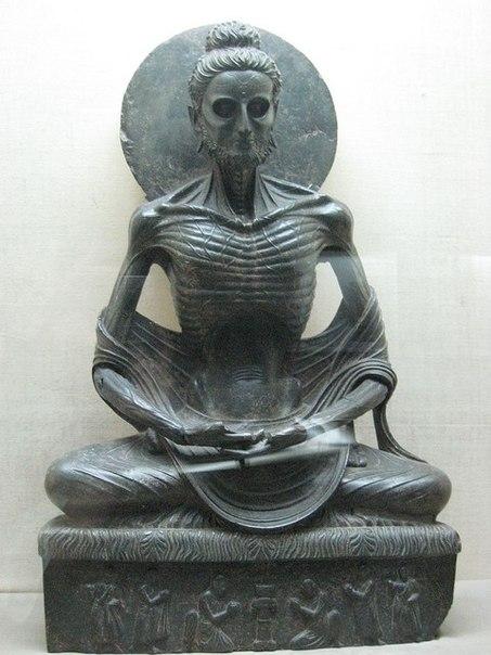 Древняя статуэтка Будды