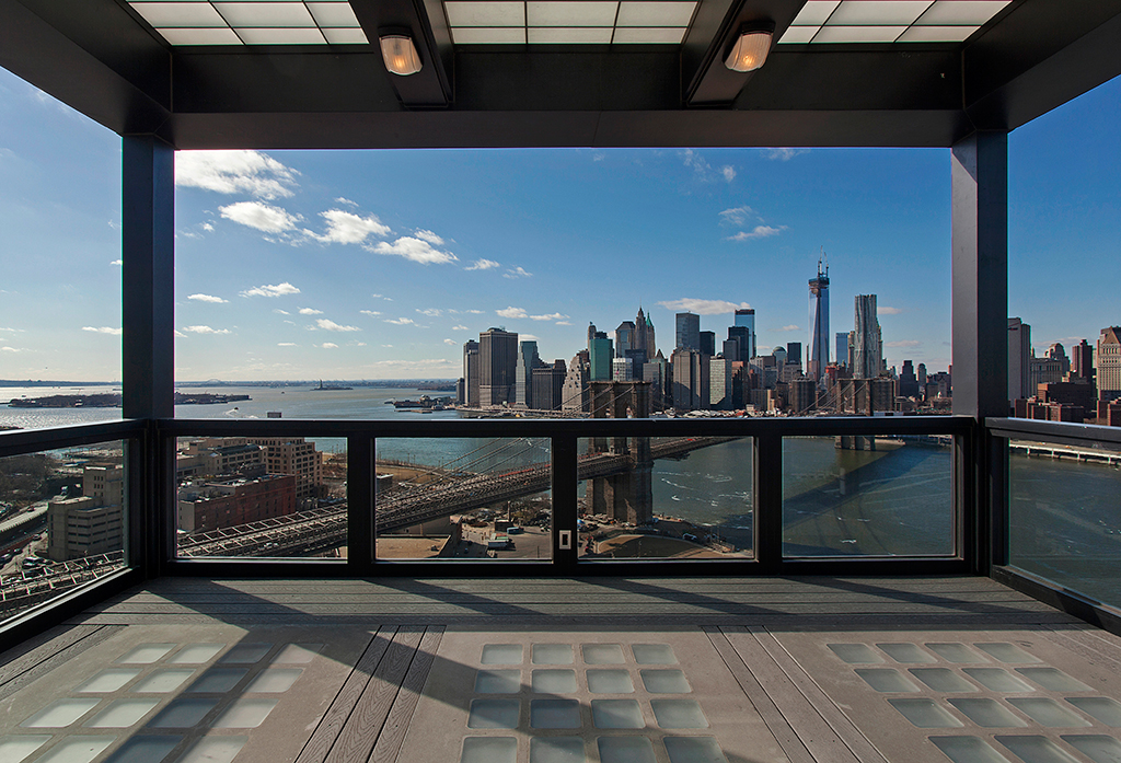 Clock-Tower-Apartment-covered-rooftop-with-views-of-New-York-CIty