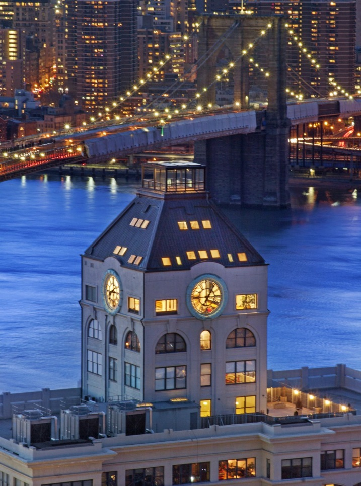 Clock-Tower-Apartment-exterior-with-rooftop-and-views-of-NYC-at-night