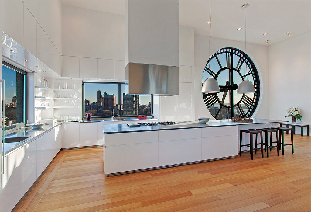 Clock-Tower-Apartment-glossy-white-open-plan-kitchen-with-island-range-and-wood-flooring